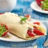 Leckerer Zitronencrêpe mit Erdbeeren